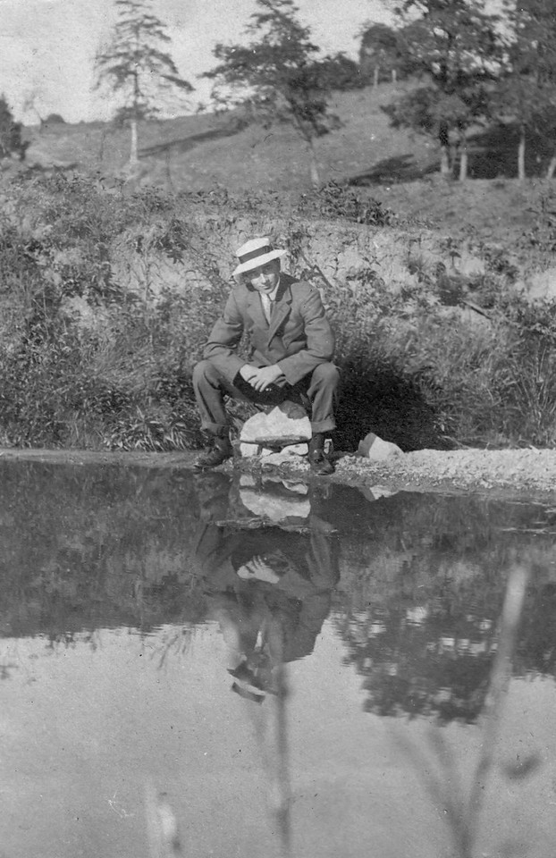Ralph Winfred Bierer sitting next to Cedar Creeek on his family farm in Front Royal, Va. The farm was part of the site for The Battle of Cedar Creek, or Battle of Belle Grove, fought October 19, 1864, which was the culminating battle of the Valley Campaigns of 1864 during the American Civil War. The farmhouse was used by both sides as a hospital during the battle.