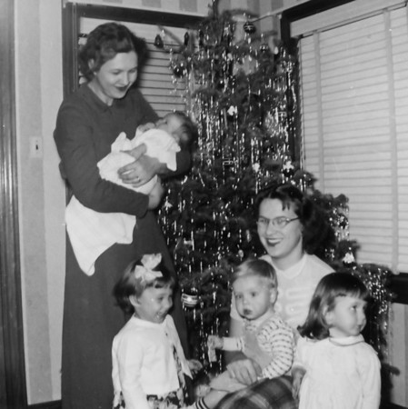 Teddy Gutowsky holding Barbara Wick, Pat, Jim and Jan with Maria Smock Christmas 1953  Teddy's house