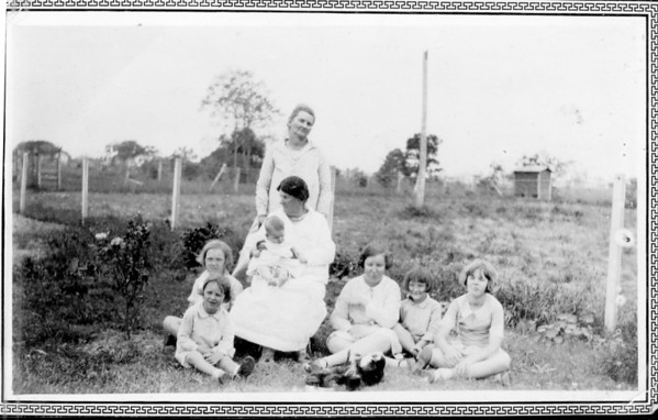 Standing: Mary Estella Seiffert Seated: Margaret Cecilia Grogan Hughes Knowlton holding Maria Jacob Left to right on grass: Clara Jacob, Frieda Jacob, Frieda Seiffert, Daria Jacob, Teddy Jacob