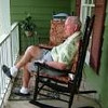 Harvey enjoying Marilyn's new rocking chairs on her front porch