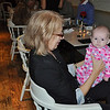 Marilyn's sister, Angie, with our grand-daughter, Madeline, waiting for the guest of honour to arrive....