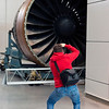 Haha! Mark taking a picture of some giant aircraft engine from a unique perspective. Udvar-Hazy Air & Space Museum. Digital, Washington, DC, March 2014. Ed