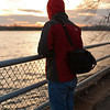 Mark looking at the sunset dipping behind the clouds over the Potomac. Digital, Washington, DC, March 2014. Ed