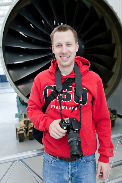 Mark standing in front of some giant aircraft engine. Udvar-Hazy Air & Space Museum. Digital, Washington, DC, March 2014. Ed