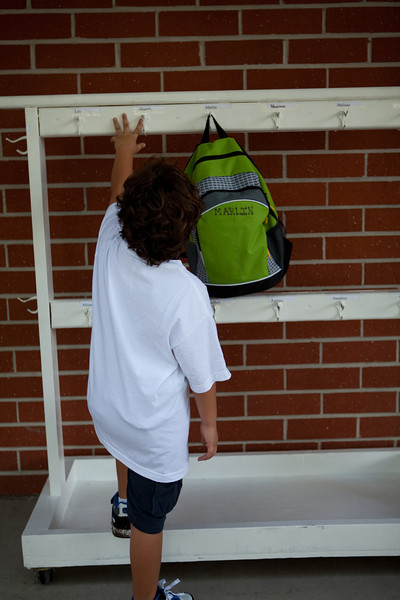 They had a rack for hanging the backpacks each with a name.  Marlin found his and was testing out hanging his bag.