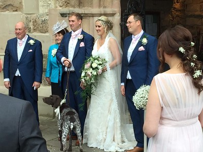Mary & Alan outside the Church complete with Otto + Alans M & D.