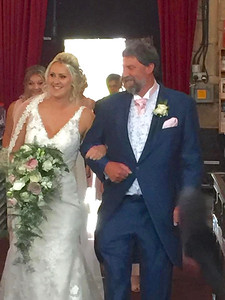 Proud Dad Neil escorting Mary into St Mary's Church