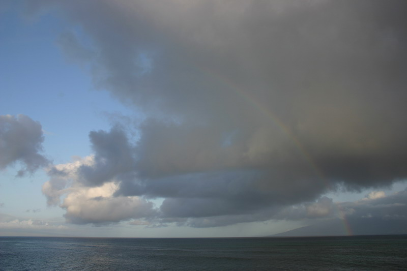 Dawn of another day in paradise!  Note rainbow near the cost of Molokai.