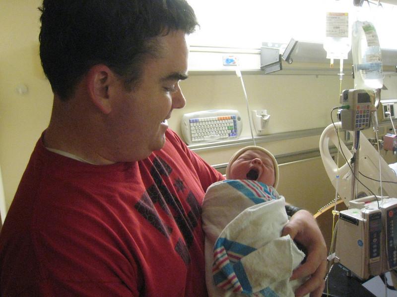 Dad's turn to hold him. Big yawn!