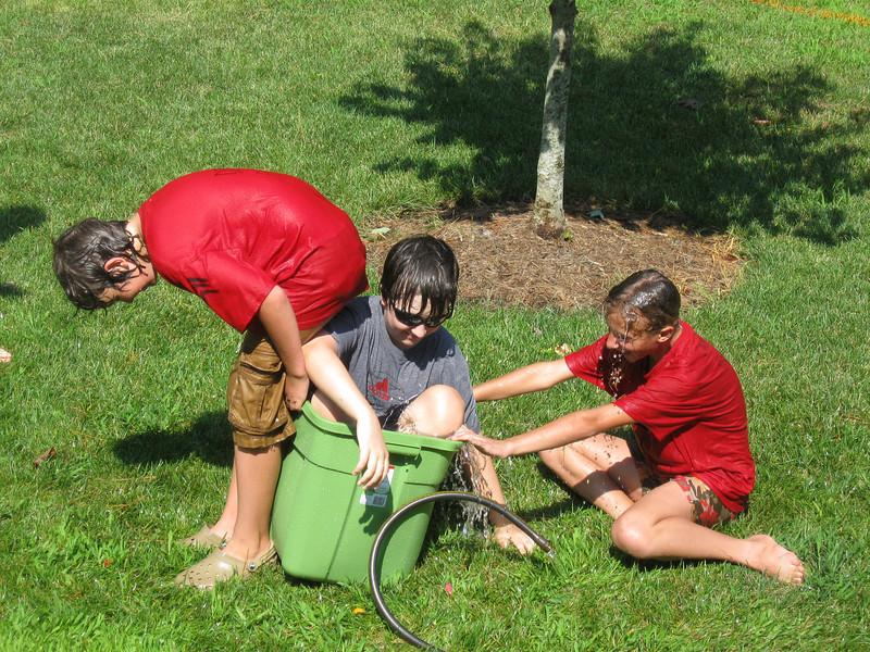 Alex and Landry try to push Matt over.