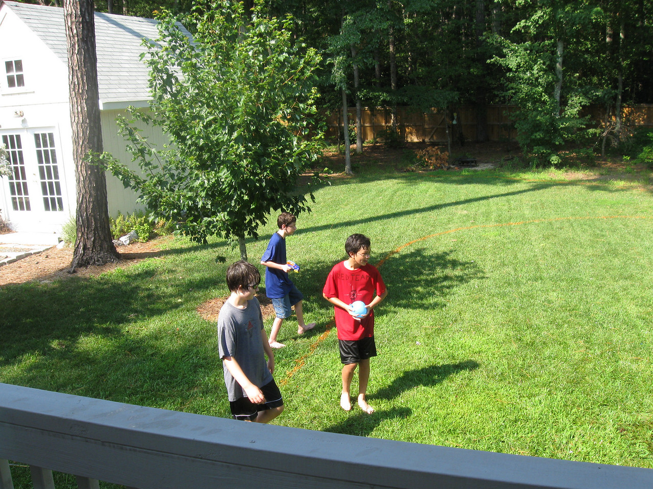 Matt, Max, and Jacob during water balloon fight.