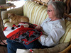 For weeks Linda has been working on a quilt for Kim's birthday.  Baxter's been keepin' her company.