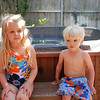 Ready to swim in Gram's hot tub in our matching suits!