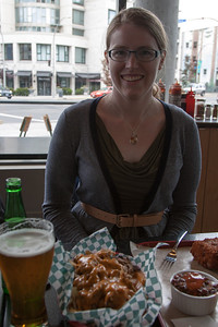 Pulled pork poutine with sides of fried mac and cheese, beans, and beer? Don't mind if we do.