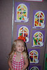 Hallie in front of her class' art work