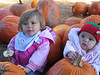 Tara Kathleen Mannion and Maya Carolan Neal with the pumpkins
