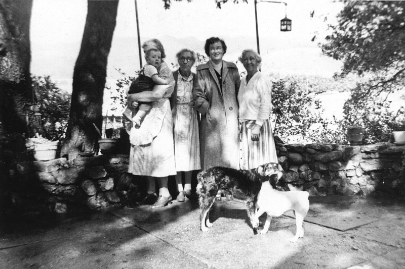 Left to right:Leroy Scott McChesney, Grandma Scott, Aunt Allie (Mary Alice Patchett), Aunt Grace (Grace Scott McChesney) Grandma (Emma Minerva Patchett McChesney)  Picture taken on the porch of Grandma's house.  oh yea, the Dogs...always had dogs.