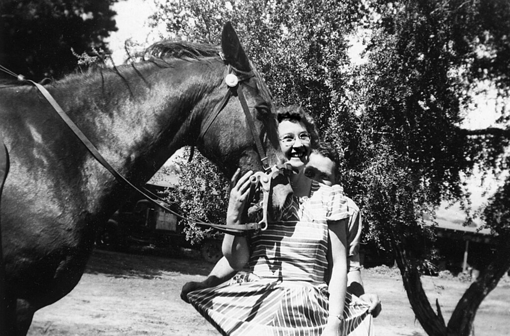 Grace Scott and Leroy Edward McChesney, Royal Oaks Dariy, April 1950.  The horse is Tony, as I recall, he stepped on my foot one time - it hurt!  In the background, you can see the old flatbed truck that was a workhorse.