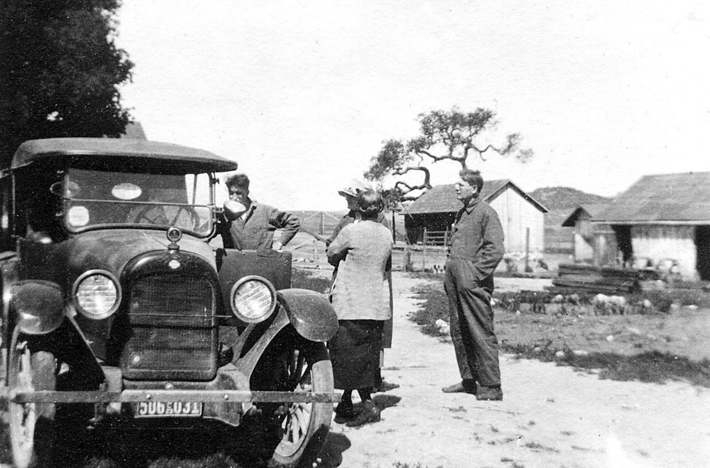 Next to the driver's door is Homer M. McChesney and the gentleman on the far right is Leroy E. McChesney Sr.  If you blow up the image, the license plate is 1923.