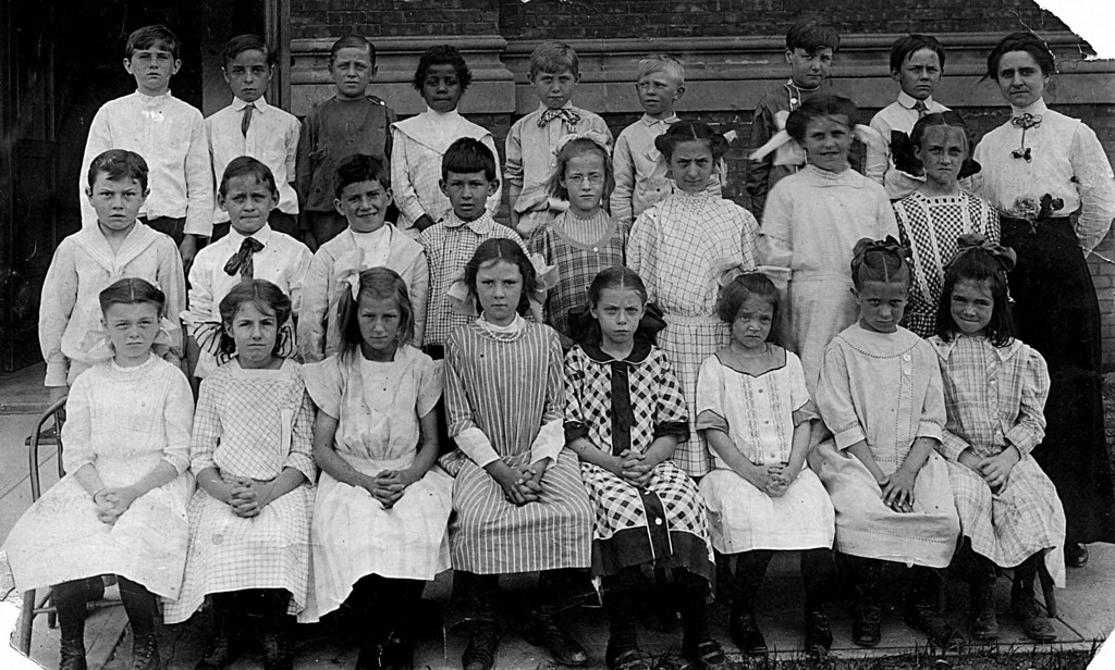 School Picture unknown date.  Homer Manson McChesney is the second from the right on the top row (excluding the teacher)