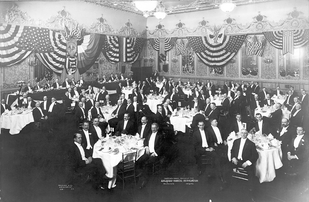 FOURTEENTH ANNUAL DINNER OF THE American Asiatic Association ASSOCIATION. on November 2, 1912.  The dinner was held at Delmonico's, Fifth Avenue and Forty-fourth street, New York, on Saturday, November 2d, at 7 p. m.   L. E. McChesney is seated facing the camera head on -- in front of the last person at the speaker's table.