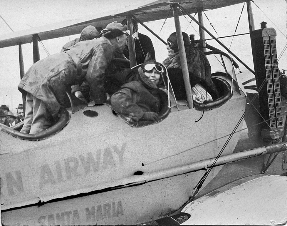 """Crash Landing at the Ranch.  as the story was told to me, Homer Manson McChesney saw the plane in trouble and it made a crash landing at the ranch.  He ran out and helped the woman out of the plane and, apprently they were able to get it off the ground again.  The back of the image says"""" in memory of my eventful air voyage, Mae Louise andersen, March 26, 1922"""""""