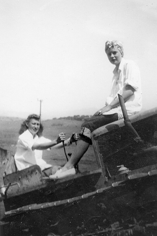 Elizabeth Barron riding on the cowel of the old D2 catipillar with her friend Gloria driving.  The D2, along with the International Harvister (TD6 ?), were the workhorses of the ranch in the 50s.