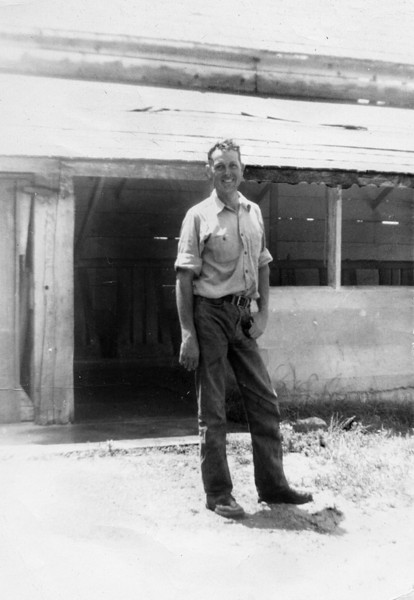 Leroy Edward McChesney Jr.  Uncle Leroy,  this is one of my favorite pictures.  I learned a lot from this man just by watching him.  He was not afraid of hard, honest work.  The milking barn, that is behind him, milked eight cows - 4 cows had the milking machines on them while the other four were getting their utters washed off.