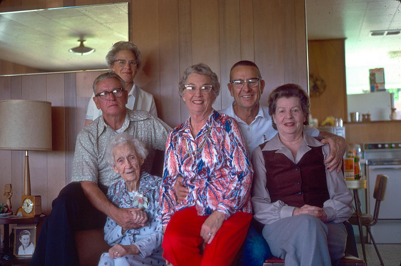 Emma Patchett McChesney's 100th birthday<br /> From the left, at the top Irene McChesney wife of Jess Milo McChesney, Jess Milo (Uncle Milo)is next to her, Below Uncle Milo, is Emma Patchett McChesney.  To her left is Grace Scott McChesney, wife of Leroy Edward McChesney, who is seated to her left (the one with the eyes closed) at the far right, is Lois Ruth Johnson McChesney, wife of Homer Manson McChesney.<br /> This photograph was taken in February 1978