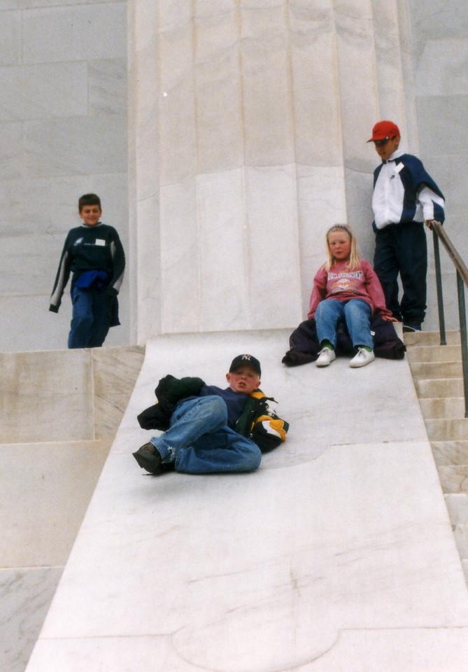 Travis sliding down the Lincoln Memorial steps