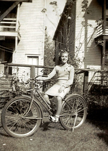 Aunt Babe and her bike 1938.  Seems it was a family controversy - no one else got a bike.