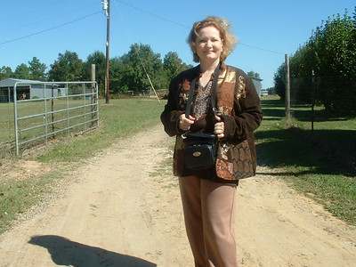 Me standing by the gate to the Farm in Boxelder TX in 2004