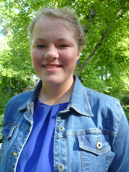 McKenna at 14.  Middle School graduation, on her way to High School.