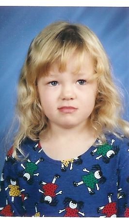 McKenna in her K-3 (Kindergarten for 3 year olds) school photo.  Doesn't look like she was having a good day, does it!