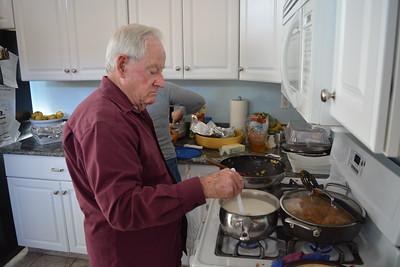 Ira helping make gravy