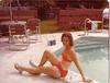 by pool in bathing suit