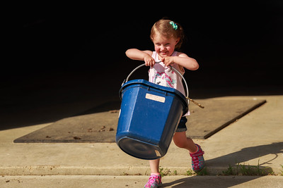 Time for Kenzie to help  with barn chores carrying the water bucket for Oscar