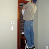 Details, details... Chris getting ready to install the heating register in the Master Bedroom.