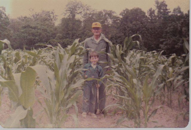 Jamie and Papa standing in the corn field.