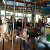 Mike emailed me this picture he took at the Vilas Zoo of Owen and Mom enjoying the merry go round.