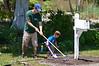Braden & Dad working on flower bed