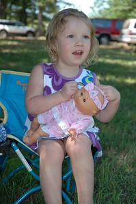 Madelynne playing with her doll.