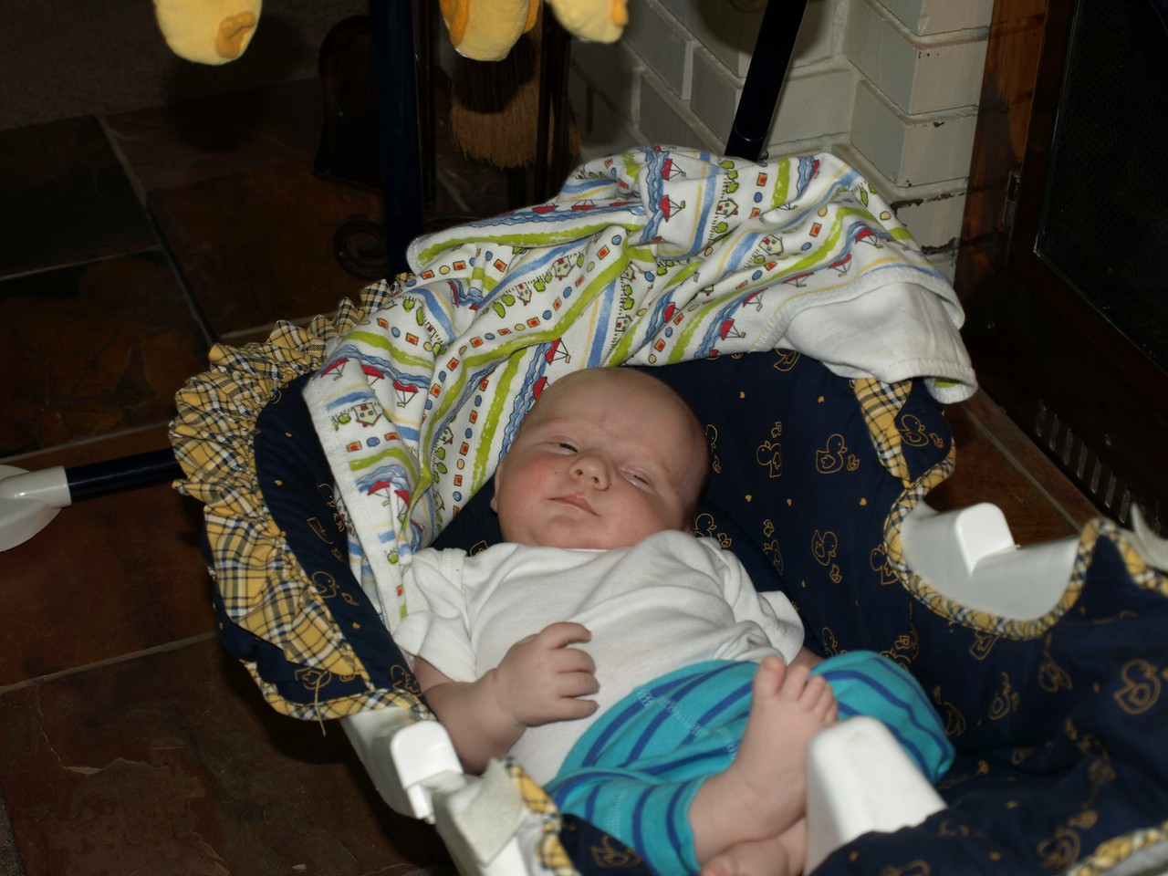 Cody loved touching the baby swing with or without baby Rooke.