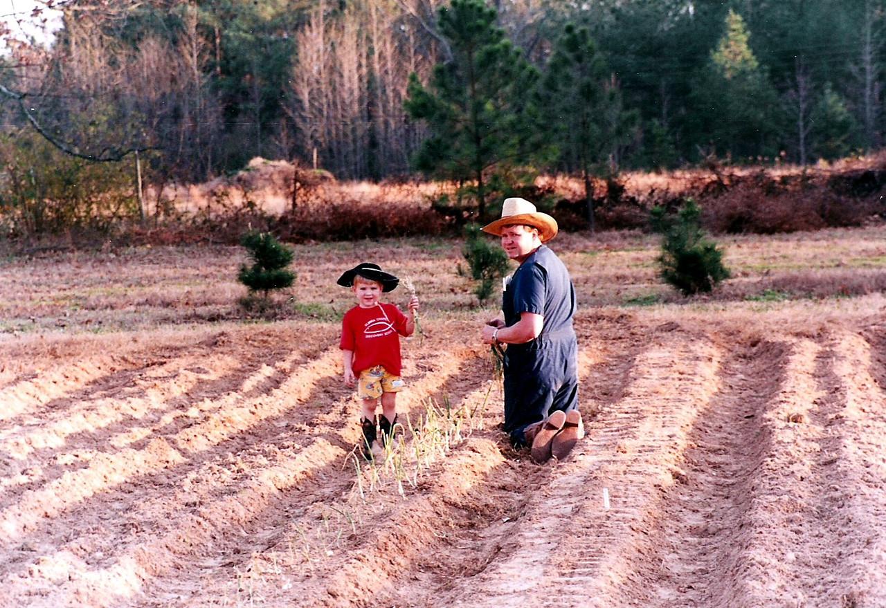 Luke and Dad gardening.