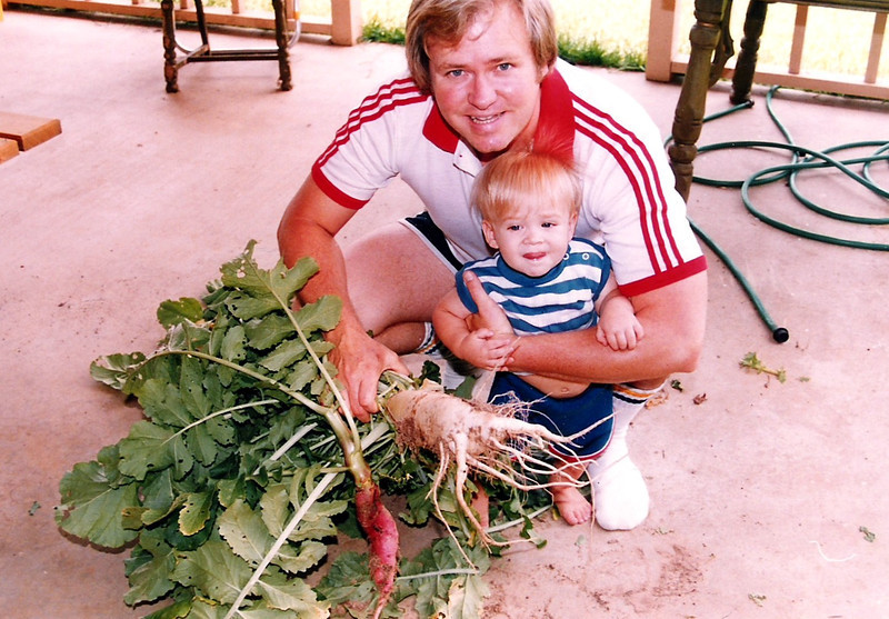 Dad and Luke showing off the garden produce.