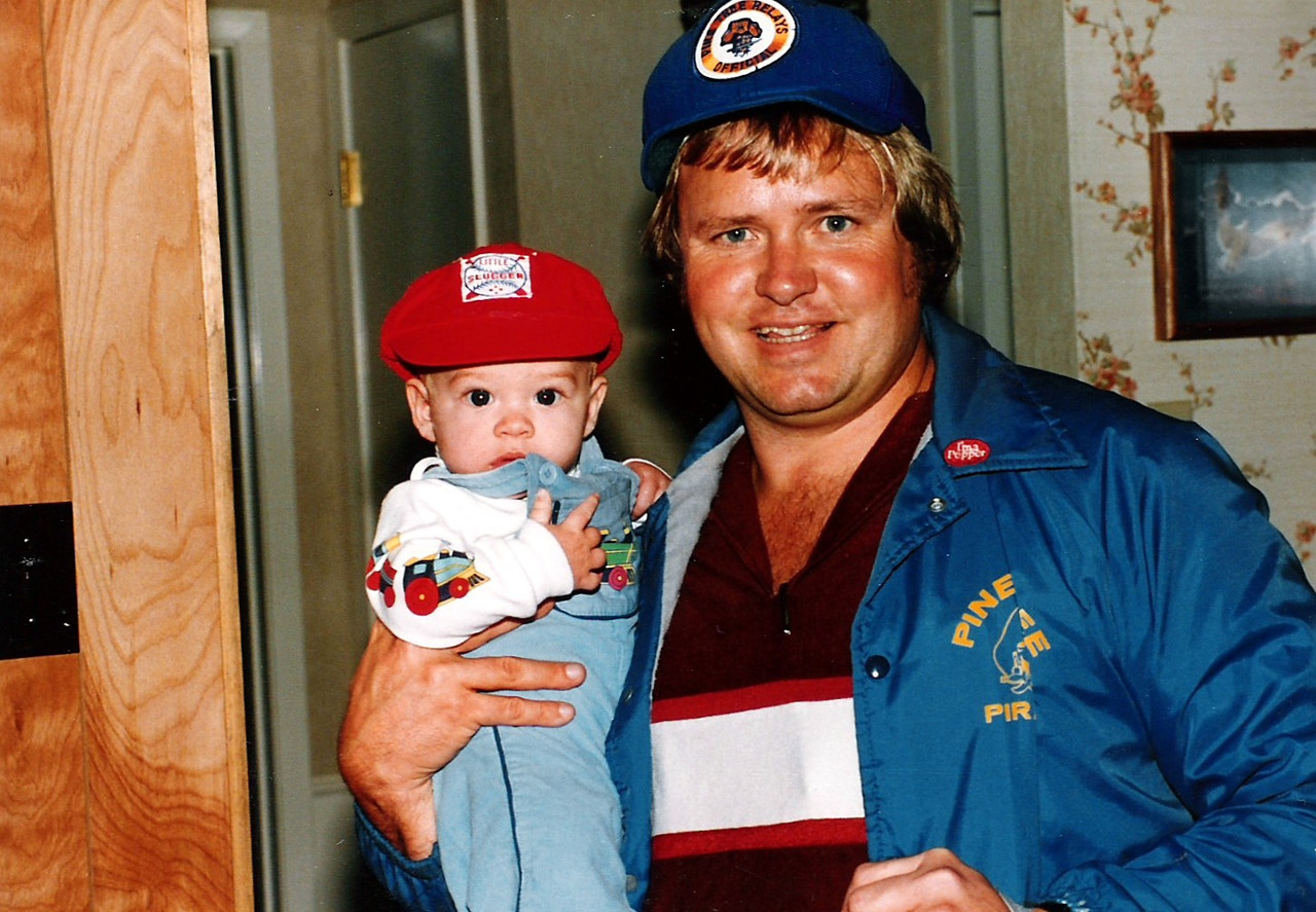 Son and father.  Luke and Ronnie with their caps