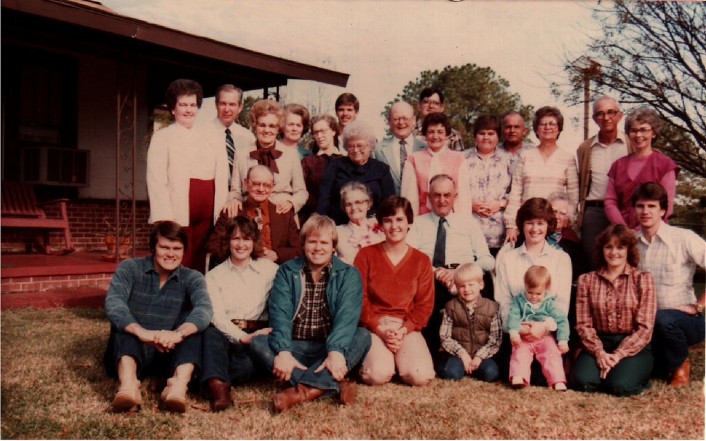 Humphries family reunion at Uncle Caps and Aunt Maurenes. Not sure what year this was.  Guess my kids had not come along yet.  Mary Jane and I both had our boots on.  These were some early but happy days. Many of these good folks have now passed on, but great memories from these days.