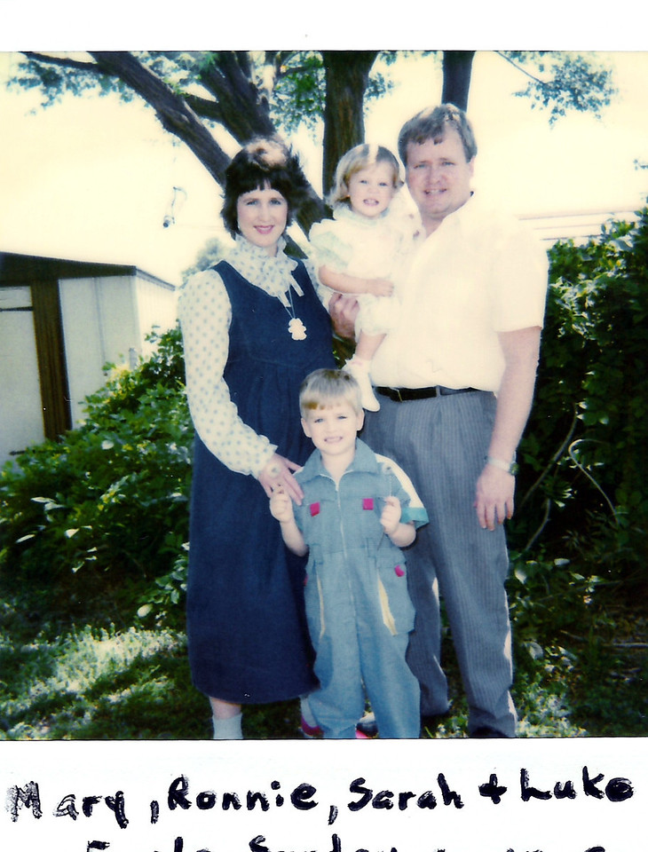 Happy Family. Mary Jane, Ronnie, Sarah, & Luke Humphries.  Katie is not born yet, but she is here.   Picture taken on 4-15-90.  Katie was born a couple of months later 6-16-90.  Taken in my mom and dads backyard.  The tree right behind us is now huge!   I love my family!