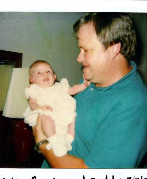 Proud Dad, holding daughter, Katie Brooke.  3 weeks.