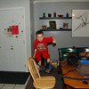 The action continued inside the house. Zac jumping from a chair to the floor.